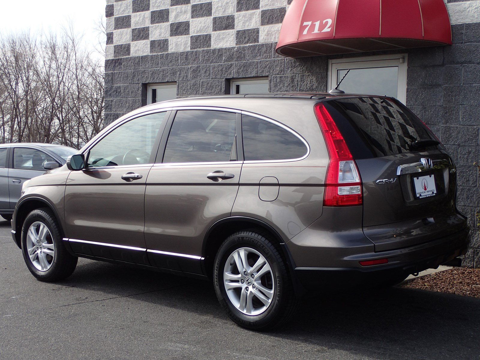 Pre owned 2010 honda cr v ex l nav sport utility in for Honda crv exl with navigation